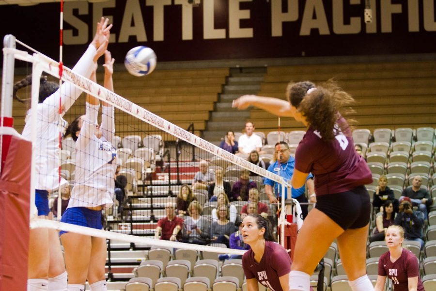 Alaska Fairbanks players jump to block a spike by SPU's Maddie Batiste during their match on Saturday, Sep. 21st.