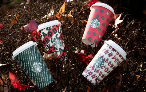 Four decorative Starbucks Holiday cups