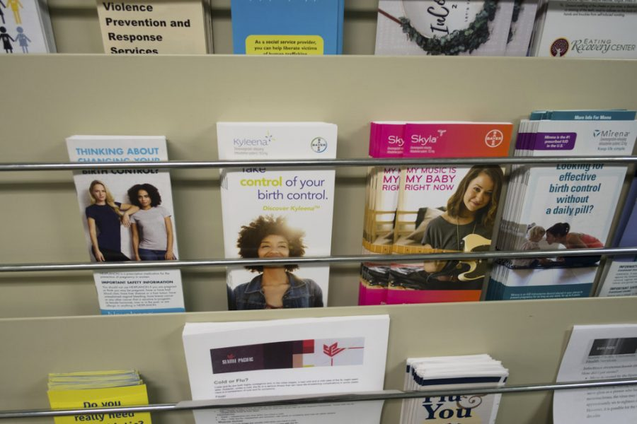 brochures in a rack, with one reading