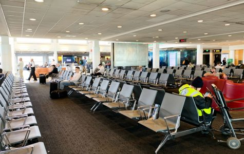 An airport gate with rows of empty seats