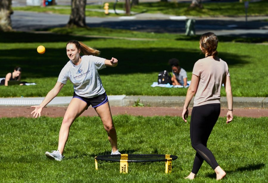 two women play a game of spikeball