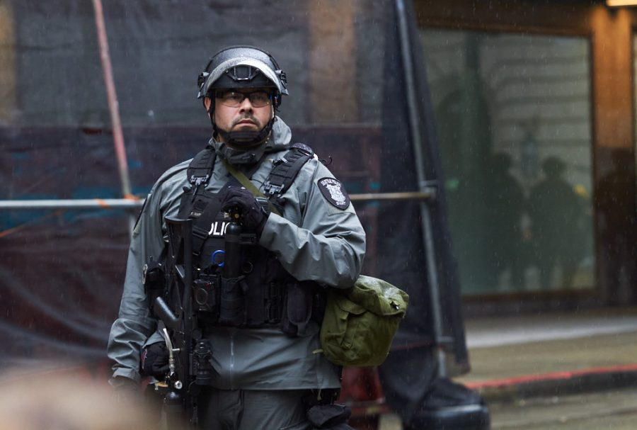 a police officer in riot gear