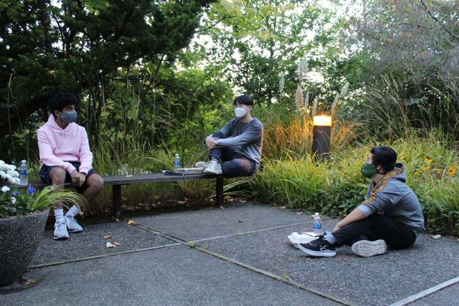 Outside Weter Hall, (left to right) David Kumar, Joo Hwan Lee, and Joshua Hyodo social distance while they have dinner, as they are unable to eat together in Gwinn Commons due to COVID guidelines.