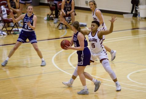 Kayla Brundidge, Sophomore biochemistry major, guards a College of Idaho player during the January 29th game.