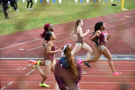 Peace Igbonagwam, Jenna Bouyer, and Julia Stepper finishing a 100m race.
