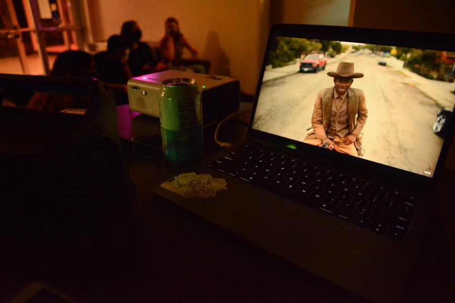 A Lil Nas X music video is playing on a laptop the night of the listening party in Weter Memorial Hall. (Devin Murray)
